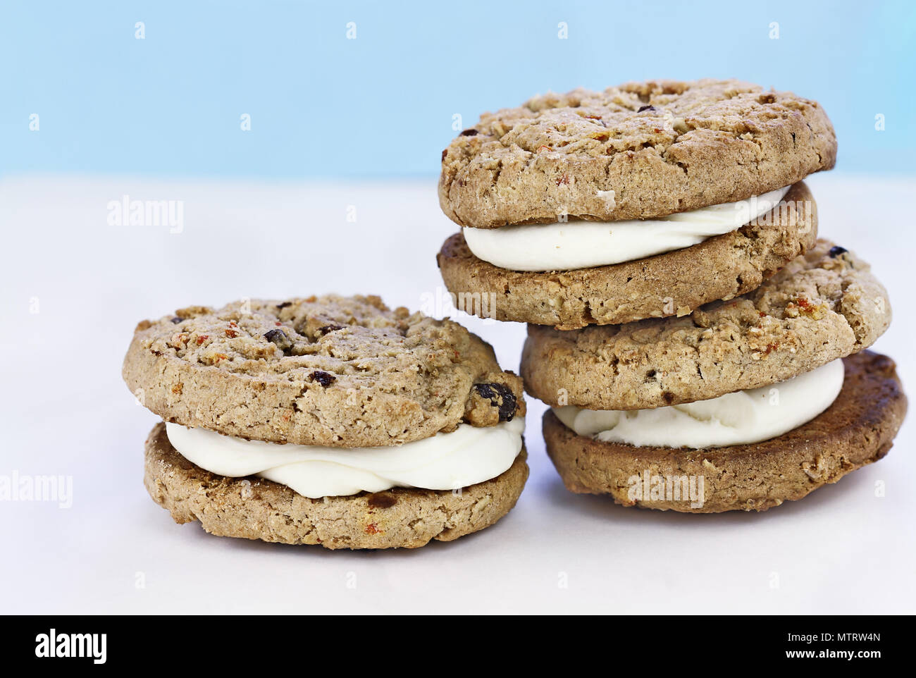 Carrot cake raisin cookies sandwiches stuffed with cream cheese icing. Room for copy text. - Stock Image