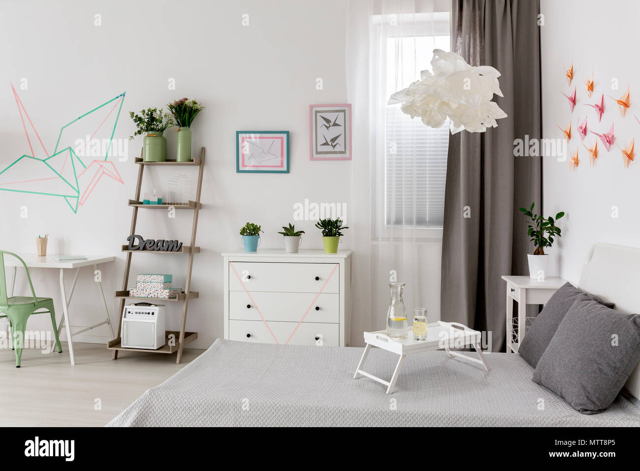 Modern white flat with office and bedroom combined and DIY decorations - Stock Image