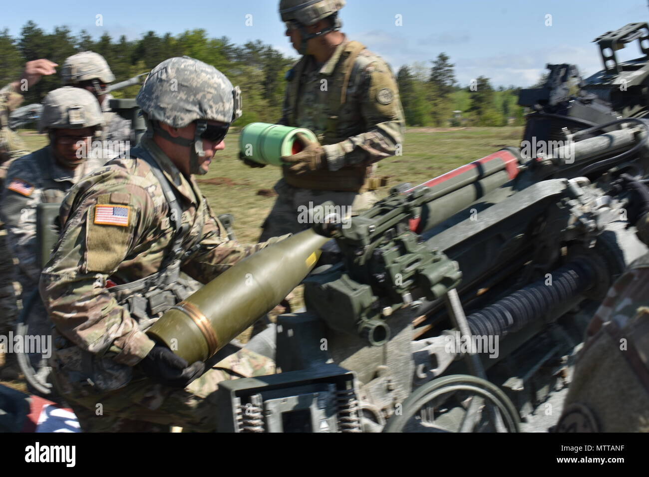 New York National Guard Pfc Justin Carpenter Assigned To Charlie Battery 1st Battalion 258th Field Artillery Loads A Round Into A M777 Howitzer On Fort Drum Watertown N Y May 22nd 2018 Carpenter
