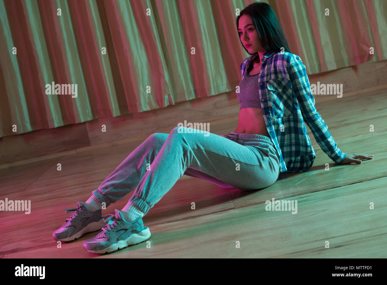 Female dancer relaxing in dance studio Stock Photo