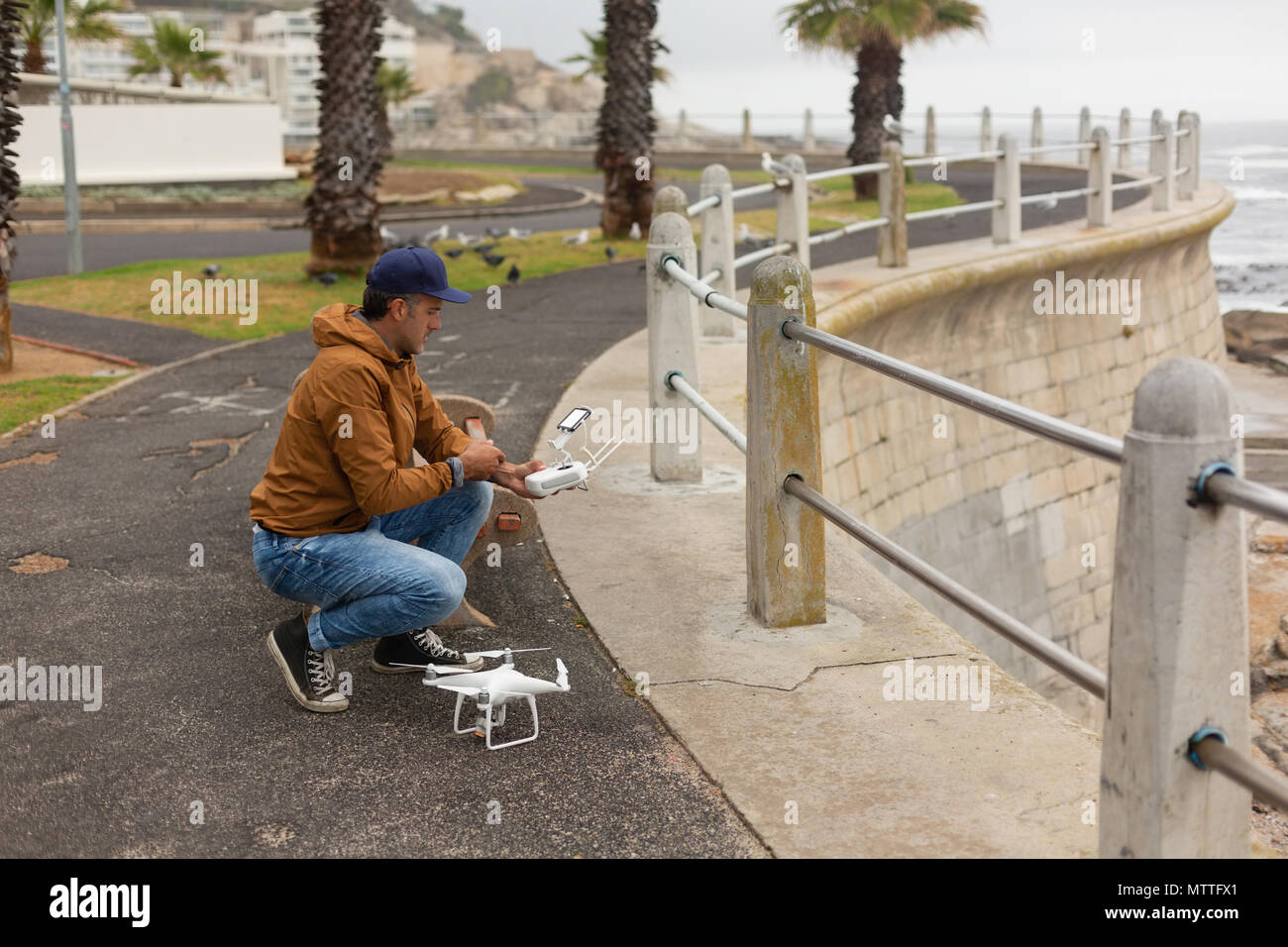 Man operating a flying drone Stock Photo
