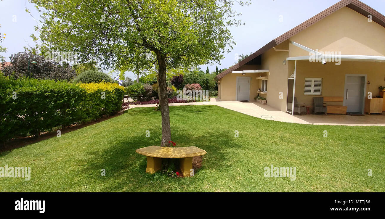 Well kept private garden with lawn and flowerbeds - Stock Image