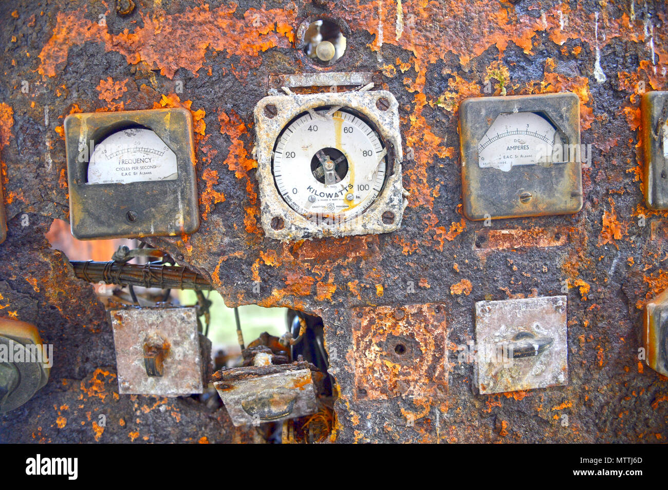 Old control panel rotted away with broken dials and falling