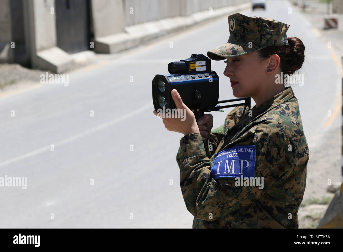 KABUL, Afghanistan (May 27, 2018) – An International Military Policewoman from the Armed Forces of Bosnia and Herzegovina conducts a routine traffic patrol at Hamid Karzai International Airport, May 27, 2018. Bosnia and Herzegovina are one of 39 nations who play an integral role in the NATO-led Resolute Support mission. (Resolute Support photo by Jordan Belser) Stock Photo