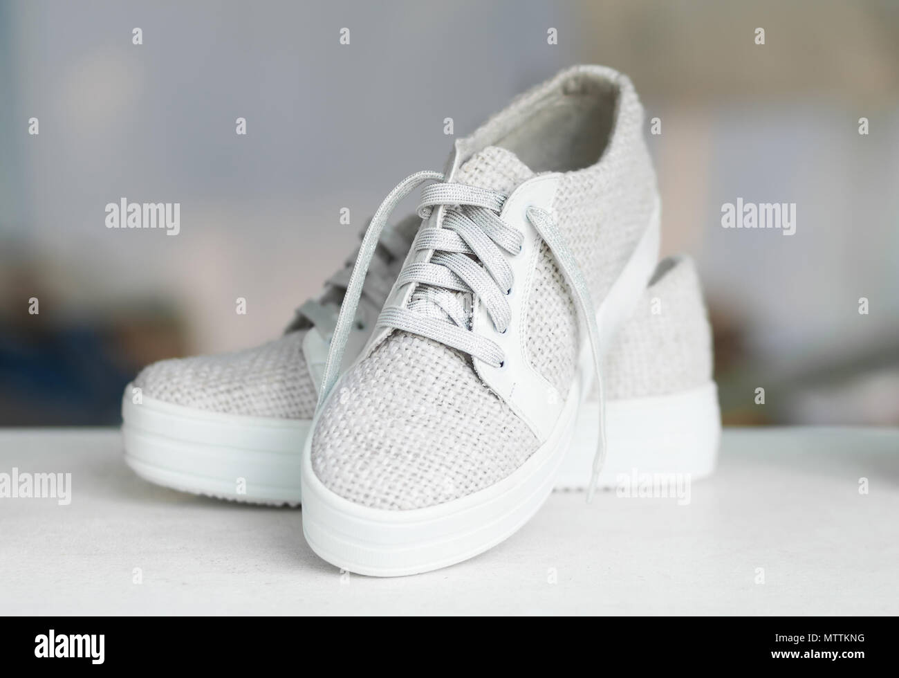 Handcrafted fashion shoes on blurry background - Stock Image