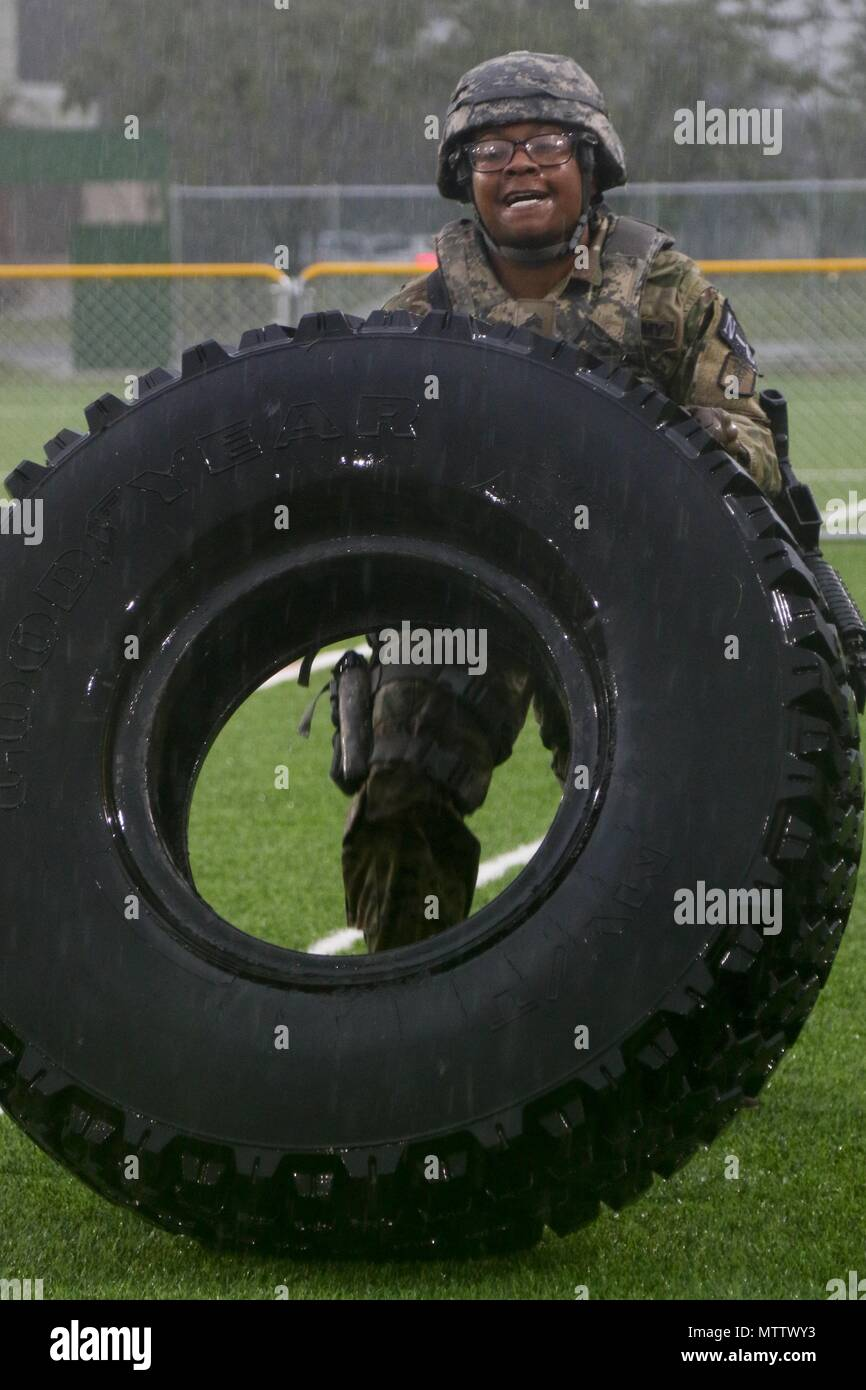 Sgt. Erika Bustamante, a Baltimore, MD native, assigned to 65th Medical Brigade, flips a tire during the physical fitness challenge portion of the Eighth Army 2018 Best Warrior Competition, held at Camp Casey, Republic of Korea, May 17, May 17, 2018. The Eighth Army Best Warrior Competition is being held to recognize and select the most qualified junior enlisted and non-commissioned officer to represent Eighth Army at the U.S. Army Pacific Best Warrior Competition at Schofield Barracks, HI. The competition will also recognize the top performing officer, warrant officer and Korean Augmentation  - Stock Image