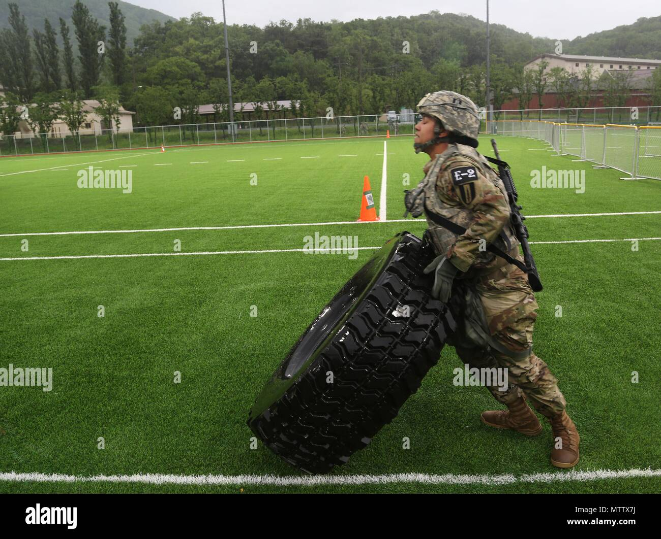 U.S. Army Pfc. Samera Taylor, a native of Lake City, FL, assigned to the 1st Signal Brigade, performs tire flips at the Physical Fitness Test during the Eighth Army 2018 Best Warrior Competition, held at Camp Casey, Republic of Korea, May 17, 2018, May 17, 2018. The Eighth Army Best warrior Competition is being held to recognize and select the most qualified junior enlisted and non-commissioned officer to represent Eighth Army at the U.S. Army Pacific Best Warrior Competition at Schofield Barracks, HI. The competition will also recognize the top performing officer, warrant officer and Korean A - Stock Image