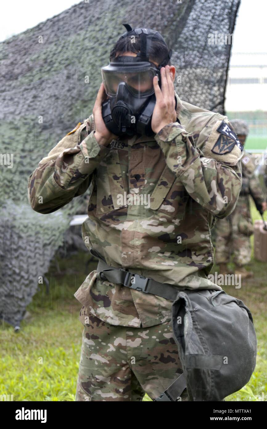 Spc, May 17, 2018. Xavier Morales, an Albuquerque, NM native, assigned to 35th Air Defense Artillery Brigade, clears his protective mask during the day stakes portion of the Eighth Army 2018 Best Warrior Competition, held at Camp Casey, Republic of Korea, May 17. The Eighth Army Best Warrior Competition is being held to recognize and select the most qualified junior enlisted and non-commissioned officer to represent Eighth Army at the U.S. Army Pacific Best Warrior Competition at Schofield Barracks, HI. The competition will also recognize the top performing officer, warrant officer and Korean  - Stock Image