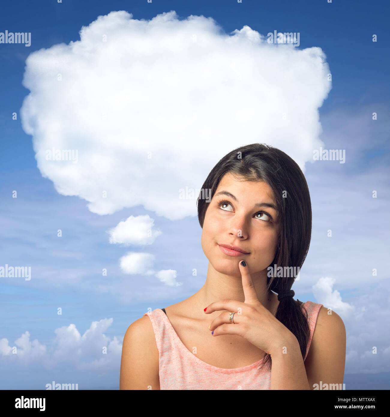 Pretty brunette girl in a thoughtful expression with a white cloud over her head - Stock Image