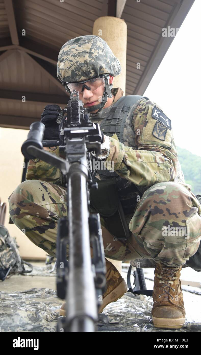 Pfc. Kim, Do, a native of Incheon, South Korea, assigned to 35th Air Defense Artillery Brigade, assembles an M240 machine gun at the day stakes challenge during the Eighth Army 2018 Best Warrior Competition, held at Camp Casey, Republic of Korea, May 17, May 17, 2018. The Eighth Army BWC is being held to recognize and select the most qualified junior enlisted and non-commissioned officer to represent Eighth Army at the U.S. Army Pacific Best Warrior Competition at Schofield Barracks, HI, in June. The competition will also recognize the top performing officer, warrant officer and Korean Augment - Stock Image