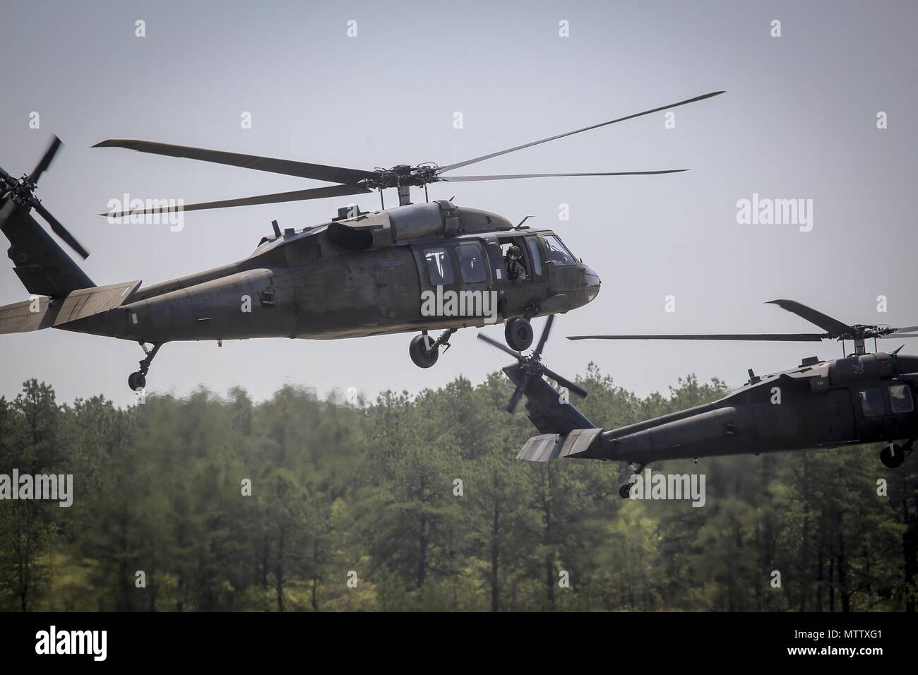 New Jersey Army National Guard UH-60L Black Hawk helicopters from the 1st Assault Helicopter Battalion, 150th Aviation Regiment lift off for a flight at Joint Base McGuire-Dix-Lakehurst, N.J. May 15, 2018, May 15, 2018. (U.S. Air National Guard photo by Master Sgt. Matt Hecht). () Stock Photo