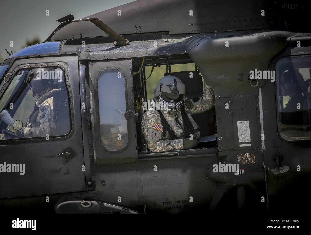 New Jersey Army National Guard Staff Sgt. John Panepinto, a UH-60L Black Hawk helicopter crew chief from the 1st Assault Helicopter Battalion, 150th Aviation Regiment sits in the gunner seat for a flight at Joint Base McGuire-Dix-Lakehurst, N.J. May 15, 2018, May 15, 2018. (U.S. Air National Guard photo by Master Sgt. Matt Hecht). () - Stock Image