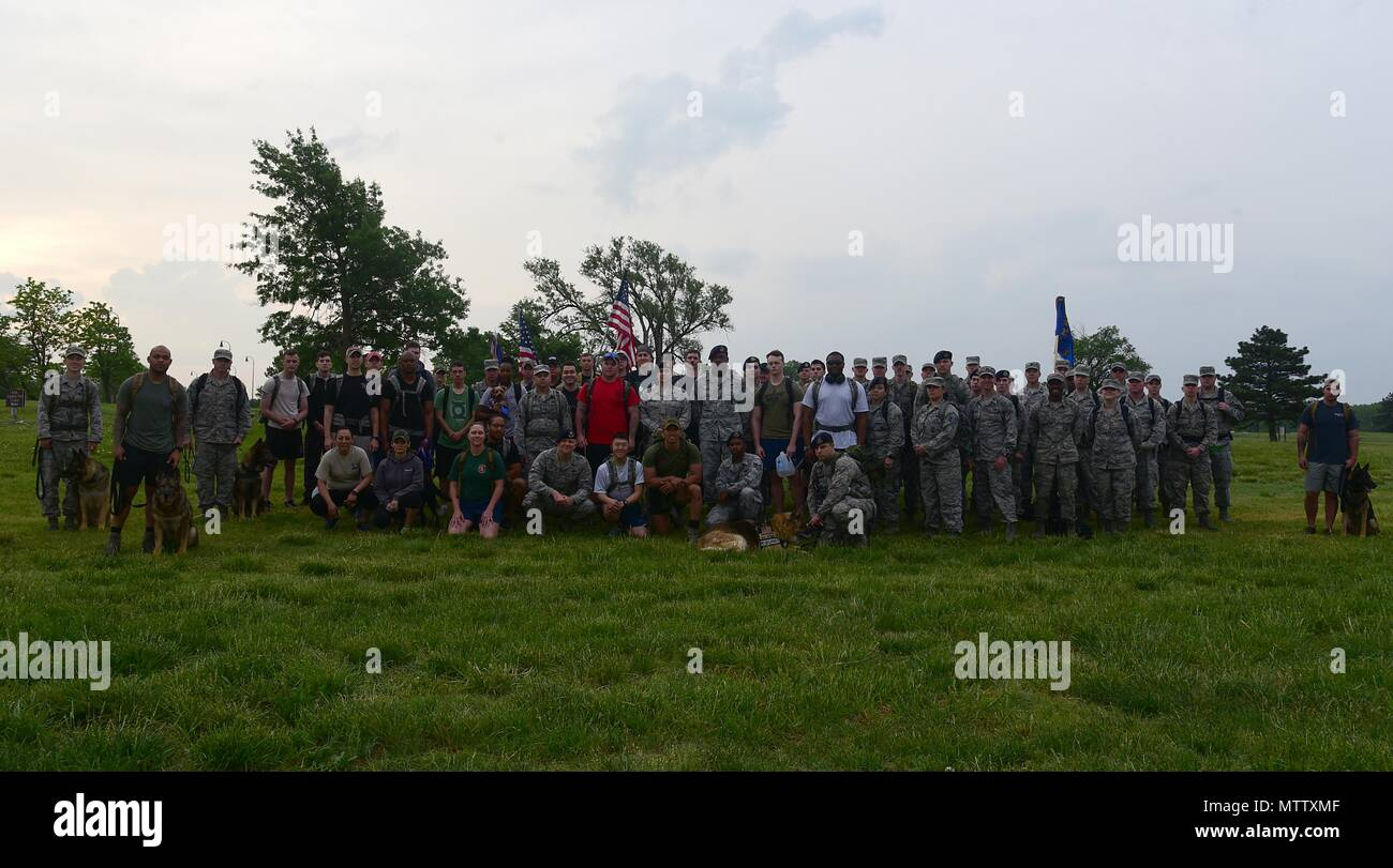 Members of Team McConnell pose for a photo May 16, 2018, at the Krueger Outdoor Track on McConnell Air Force Base, Kansas, May 16, 2018. Members gathered in the morning to begin a ruck march in honor of fallen security forces and Office of Special Investigations brethren during National Police Week. (U.S. Air Force by Airman 1st Class Alan Ricker). () - Stock Image