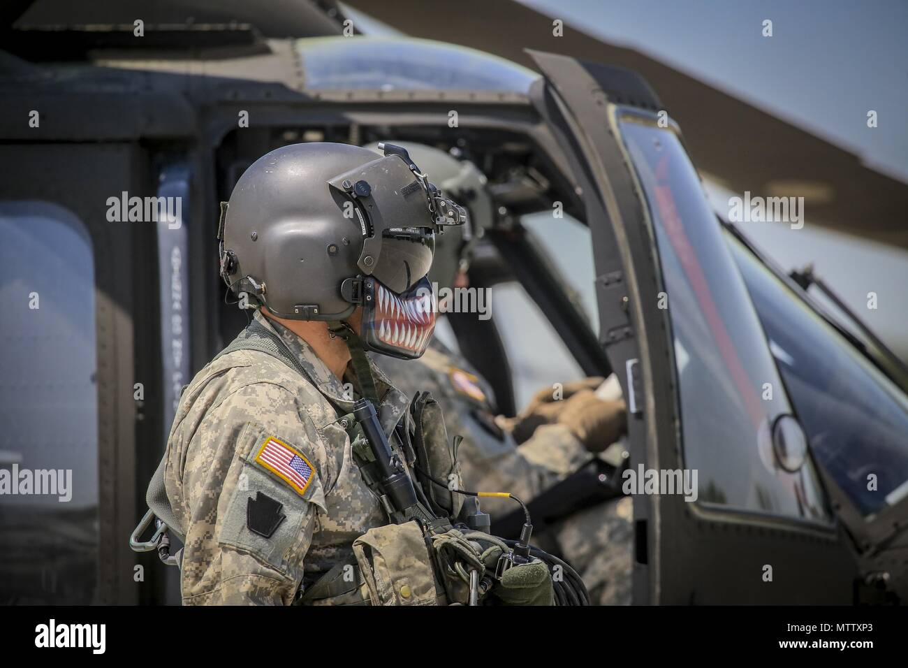 New Jersey Army National Guard Sgt. Daniel Rivera, a UH-60L Black Hawk helicopter crew chief from the 1st Assault Helicopter Battalion, 150th Aviation Regiment, prepares his aircraft for a flight at Joint Base McGuire-Dix-Lakehurst, N.J. May 15, 2018, May 15, 2018. (U.S. Air National Guard photo by Master Sgt. Matt Hecht). () - Stock Image