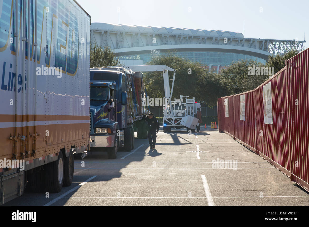 Trucks stand in a line as officers with the U.S. Customs and Border Protection Office of Field Operations conduct inspections of commercial trucks and concession vehicles as they arrive at NRG Stadium in preparation for Super Bowl 51 in Houston, Texas, Jan. 30, 2017. Vehicles are scanned by x-ray prior to entry into the main stadium facilities. U.S. Customs and Border Protection Photo by Ozzy Trevino - Stock Image