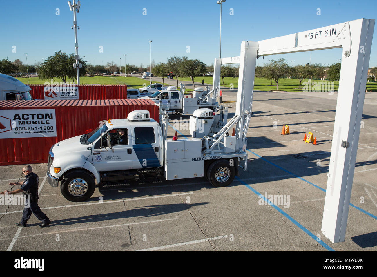 Officers with the U.S. Customs and Border Protection Office of Field Operations conduct inspections of commercial trucks and concession vehicles as they arrive at NRG Stadium in preparation for Super Bowl 51 in Houston, Texas, Jan. 30, 2017. Vehicles are scanned by x-ray prior to entry into the main stadium facilities. U.S. Customs and Border Protection Photo by Ozzy Trevino Stock Photo