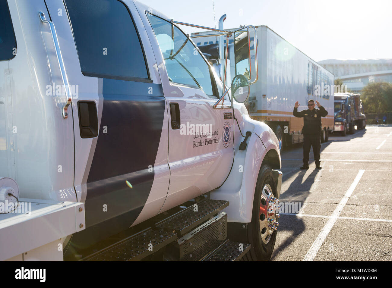 Officers with the U.S. Customs and Border Protection Office of Field Operations conduct inspections of commercial trucks and concession vehicles as they arrive at NRG Stadium in preparation for Super Bowl 51 in Houston, Texas, Jan. 30, 2017. Vehicles are scanned by x-ray prior to entry into the main stadium facilities. U.S. Customs and Border Protection Photo by Ozzy Trevino - Stock Image