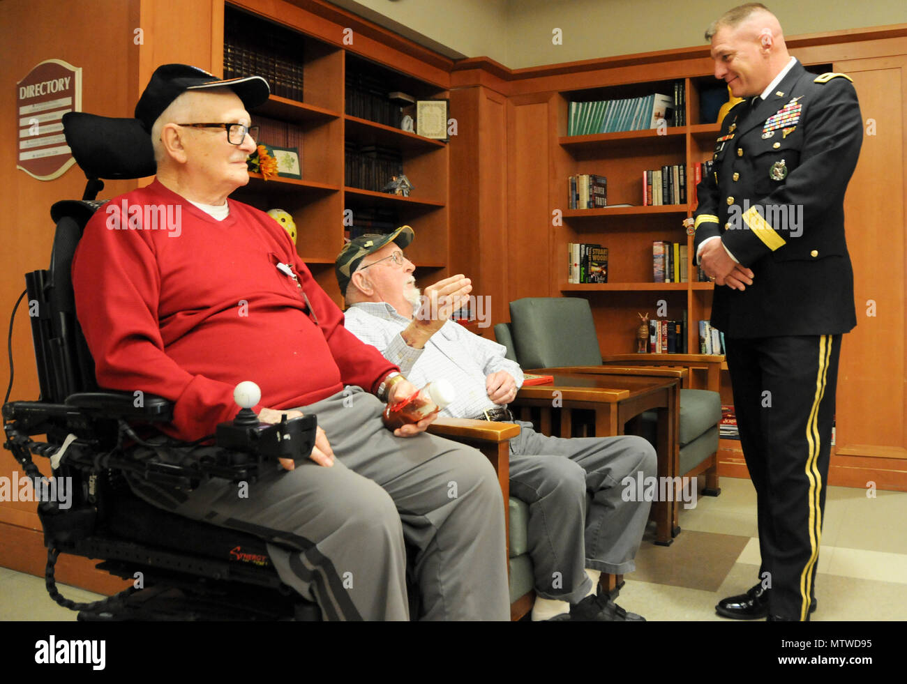 Maj. Gen. Troy D. Kok, commanding general of the U.S. Army Reserve's 99th Regional Support Command headquartered at Joint Base McGuire-Dix-Lakehurst, New Jersey, meets with (from left) George A. Teale, an Army private who served in World War II, and Larry H. Stange, a Marine sergeant who served in Korea, during a Jan. 28 visit to the New Jersey Department of Military and Veterans Affairs' Veterans Memorial Home in Vineland, New Jersey. The purpose of Kok's visit was to thank veterans for their service and encourage young Soldiers to spend time with veterans in their local area. - Stock Image