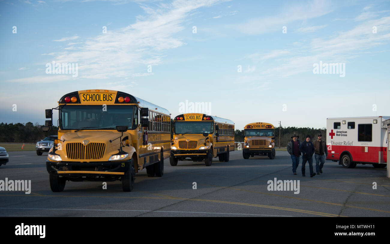 Buses full of volunteers wait to drive to the disaster site, Jan. 28, 2017, in Adel, Ga. Hundreds of volunteers aided in relief efforts after the tornado killed 15 people and was later deemed an EF3, the strongest tornado to touch down in the county's history. (U.S. Air Force photo by 2d Lt. Kaitlin Toner) - Stock Image