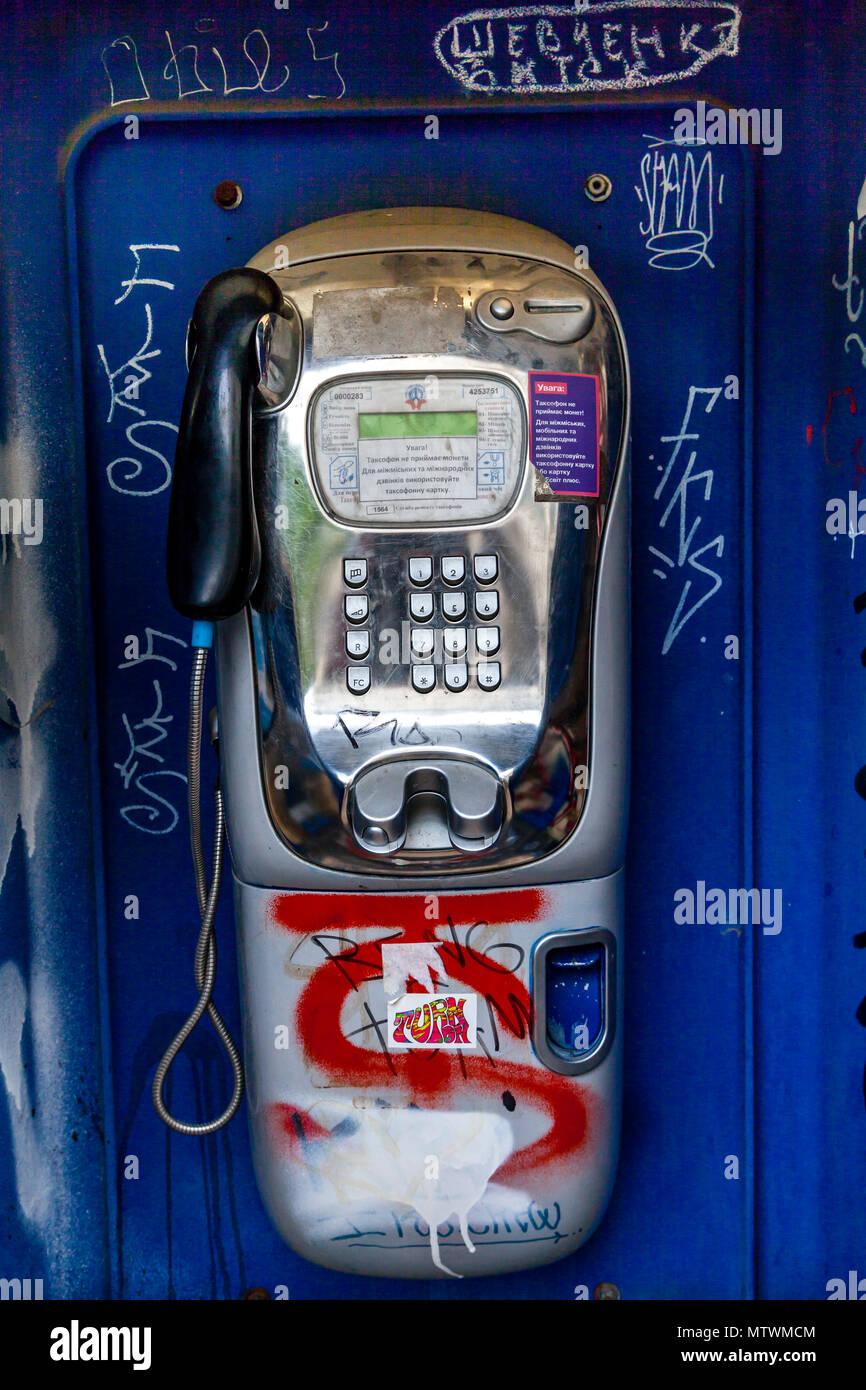 A Telephone Box and Graffiti, Kiev, Ukraine - Stock Image