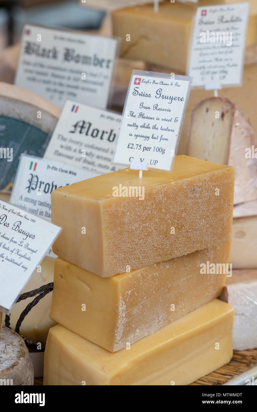 Swiss gruyere cheese. Speciality and Artisan cheese stall at a food festival. Oxfordshire, England - Stock Image