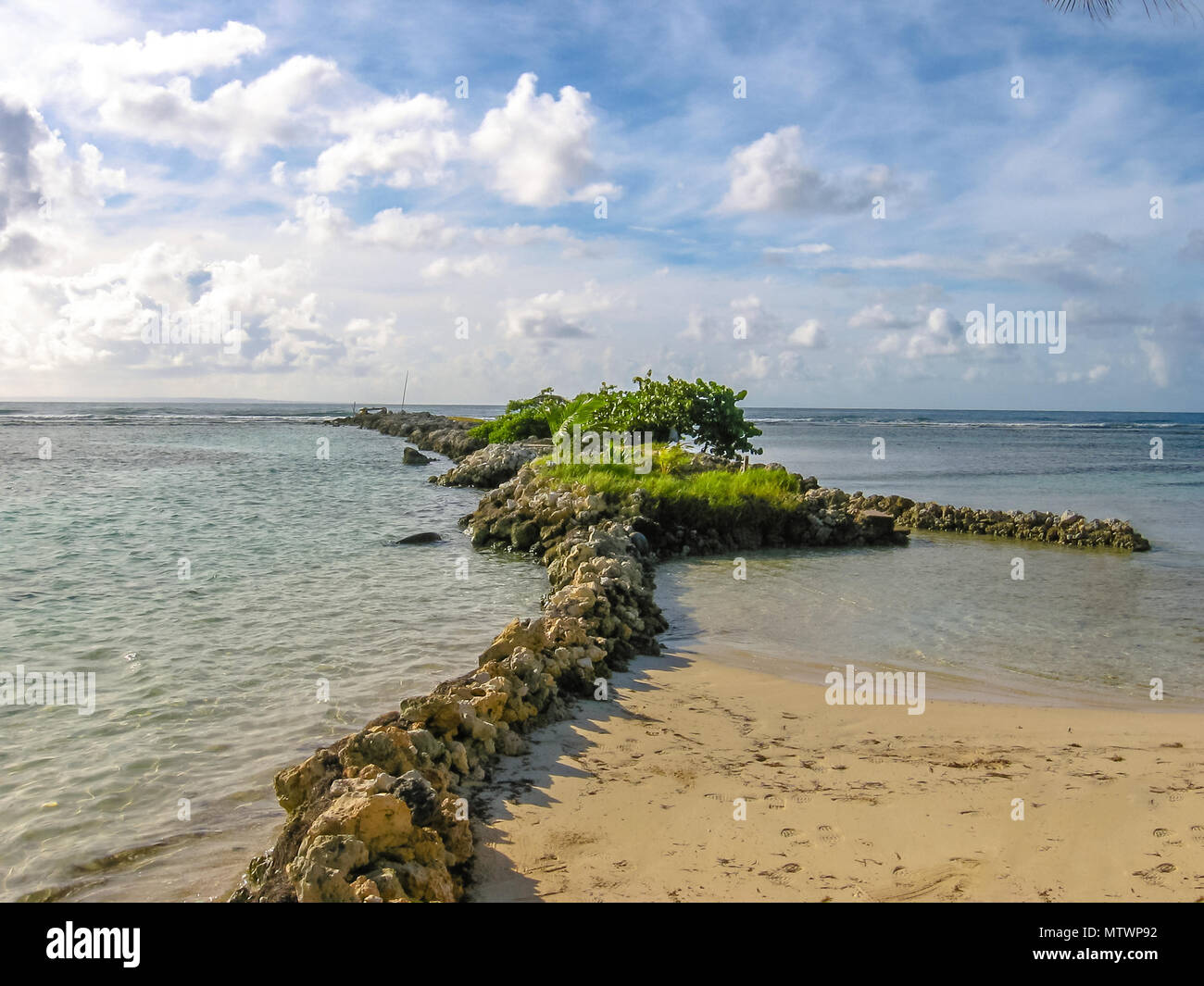 The famous beach of Sainte Anne divided into two bays with calm and transparent sea. Guadeloupe, French Caribbean, Antilles. - Stock Image