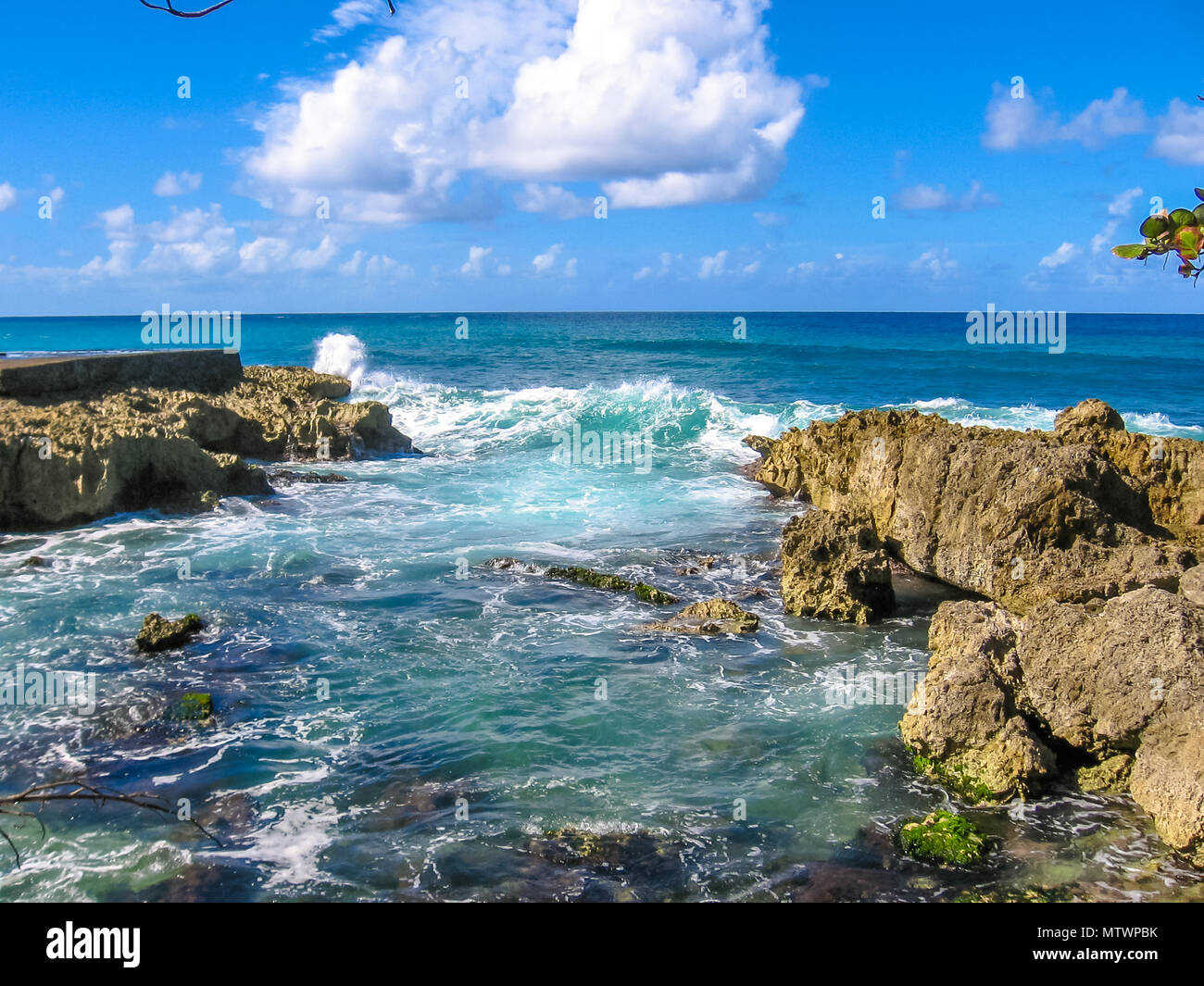 Rocks and strong waves crashing on rocks in the wild north coast of Guadeloupe, Caribbean, French West Indies. - Stock Image