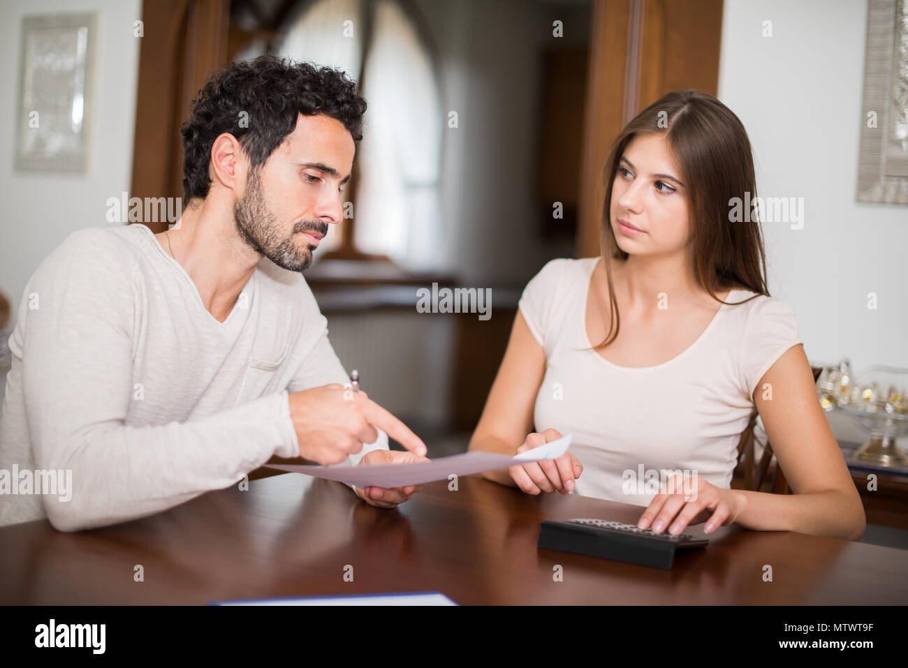 Couple calculating their expenses together Stock Photo