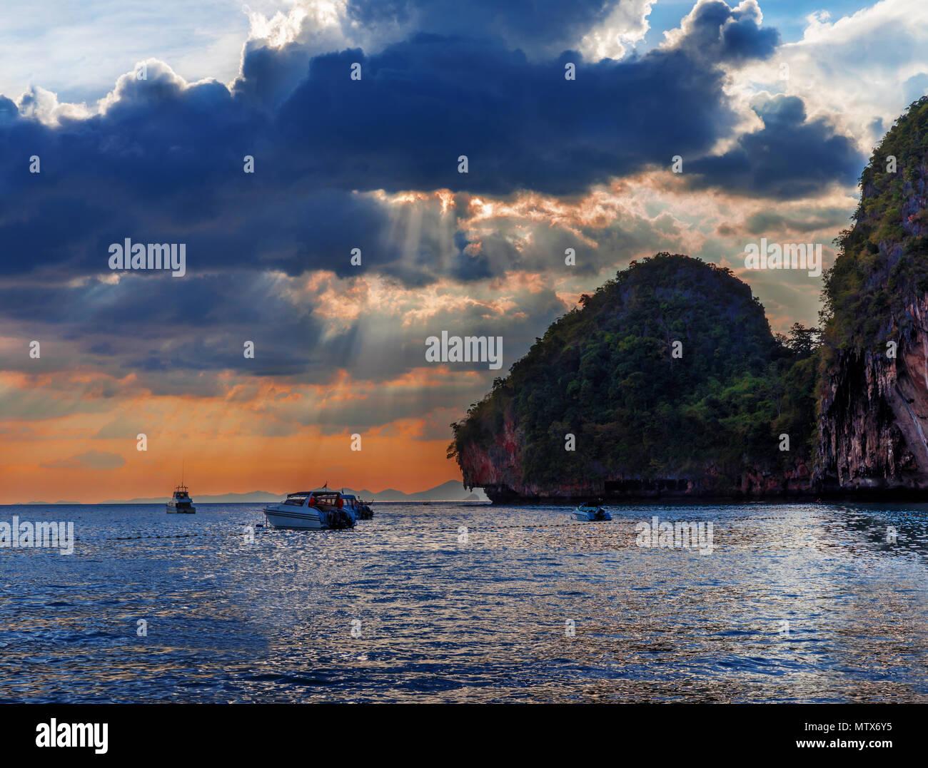Popular travel tropical karst rocks perfect for climbing Phra Nang Cave Beach in sunset, Krabi province, Thailand Stock Photo
