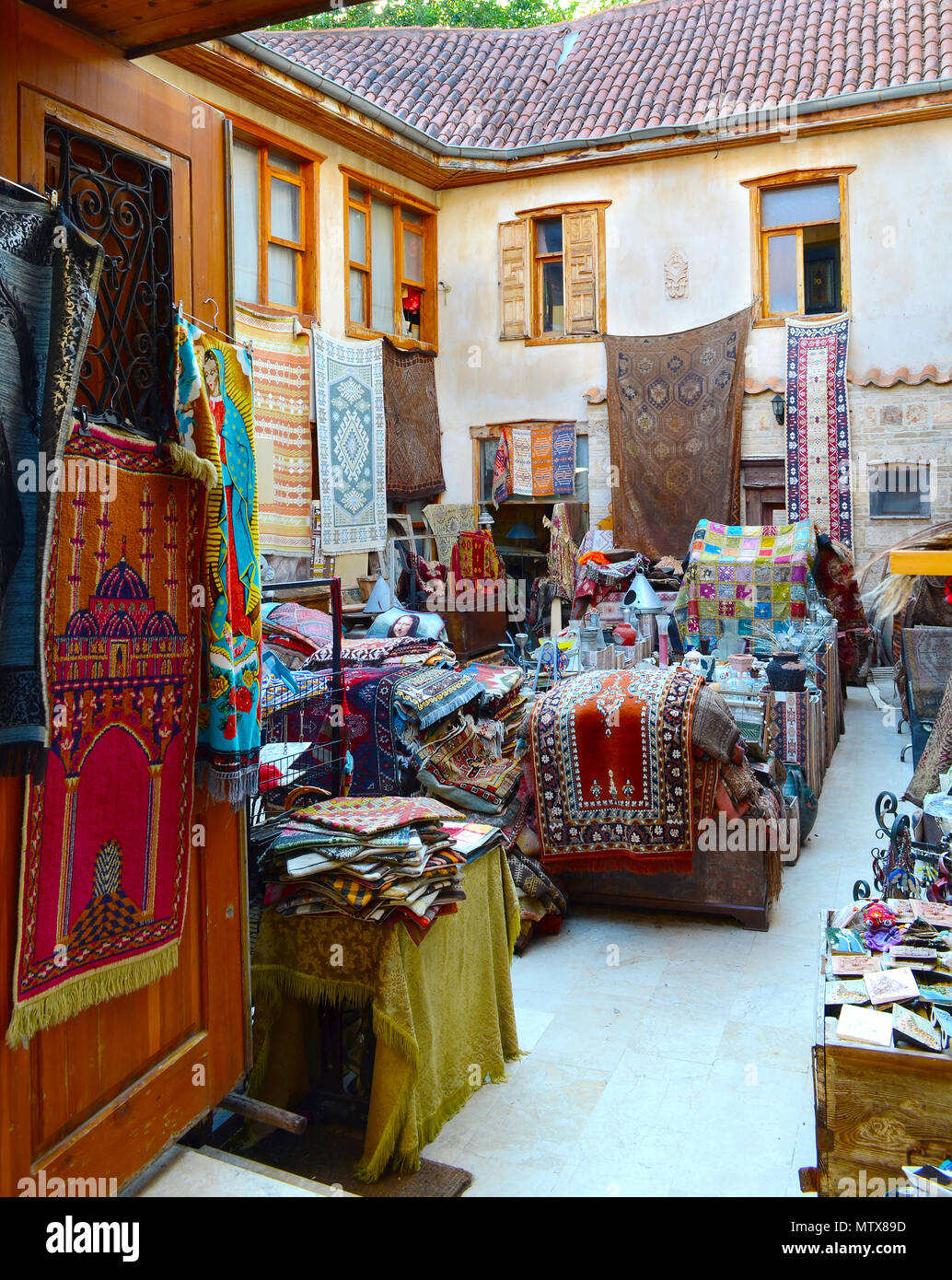 Store carpets and old things in the easten town. - Stock Image