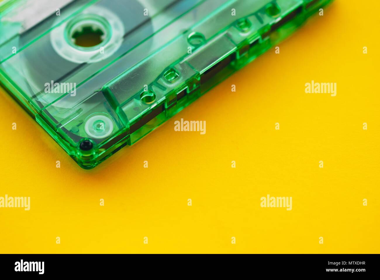 Audio cassette tape on yellow background, retro vintage technology - Stock Image
