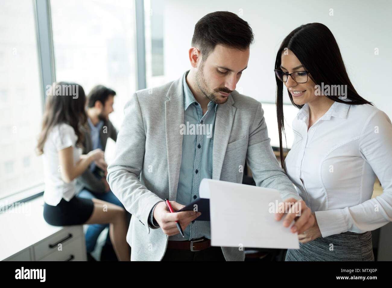 Picture of business people discussing in office - Stock Image