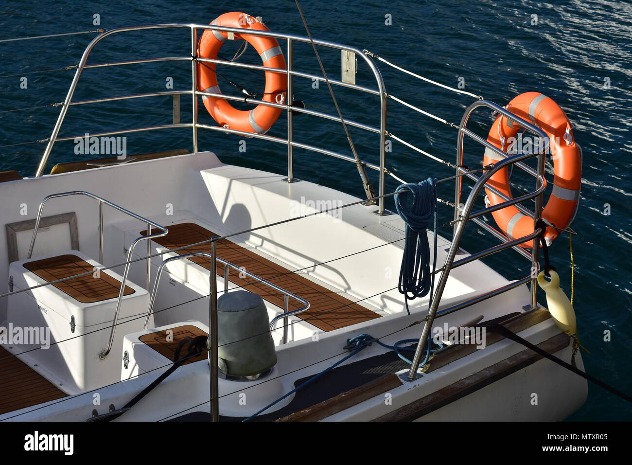 Cockpit Of White Sail Boat Surrounded By Stainless Steel