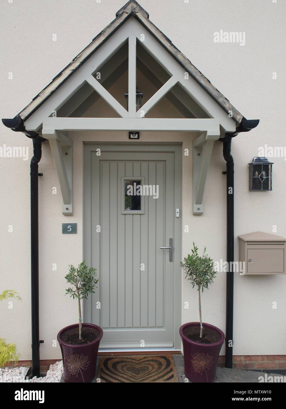 Front Door Storm Porch And Two Small Olive Trees With Letterbox And