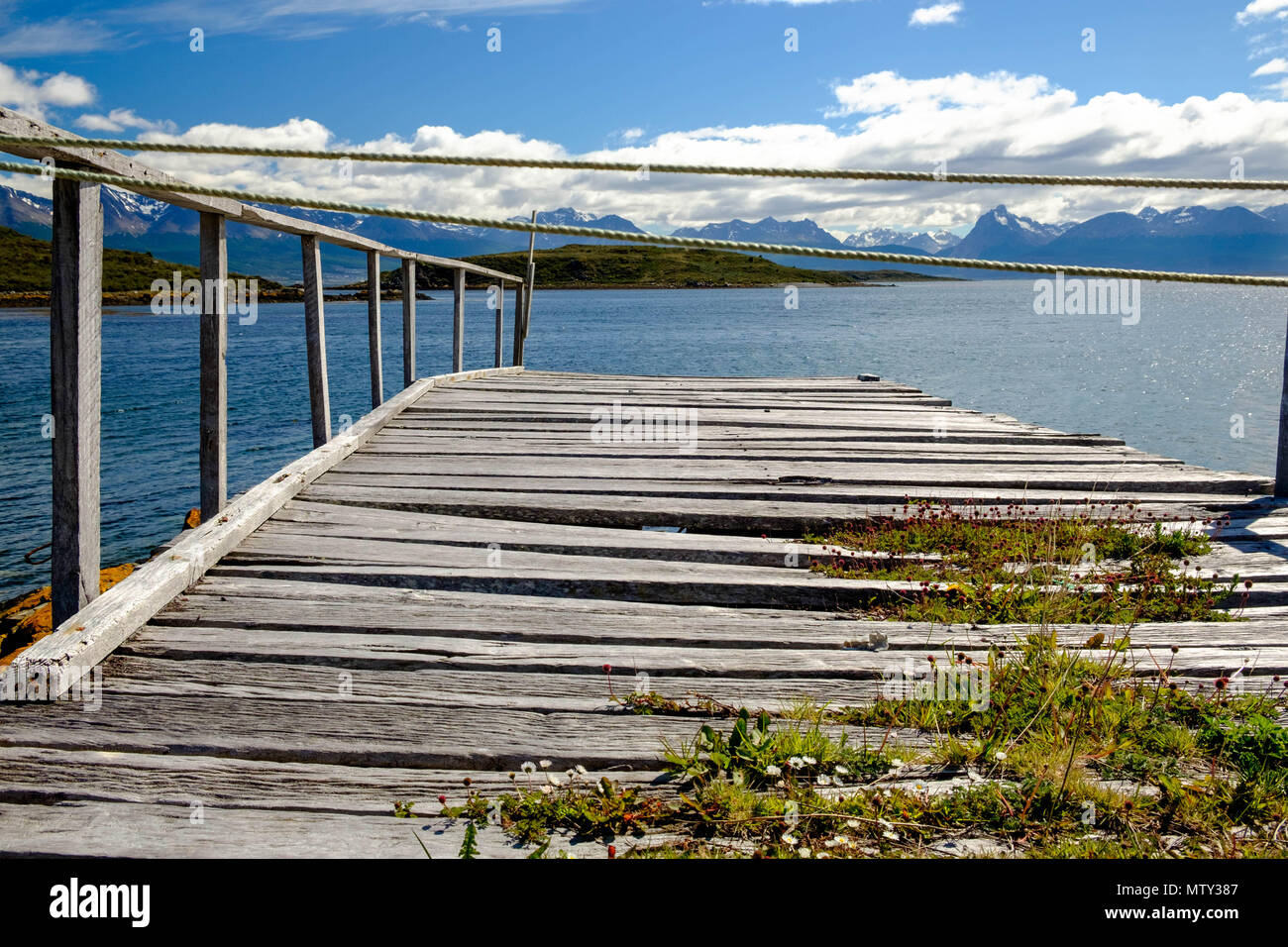 An old pier in Puerto Navarino shows the Beagle Channel and its surroundings. This part of Chile, Isla Navarino, is rather wild and adventurous. - Stock Image