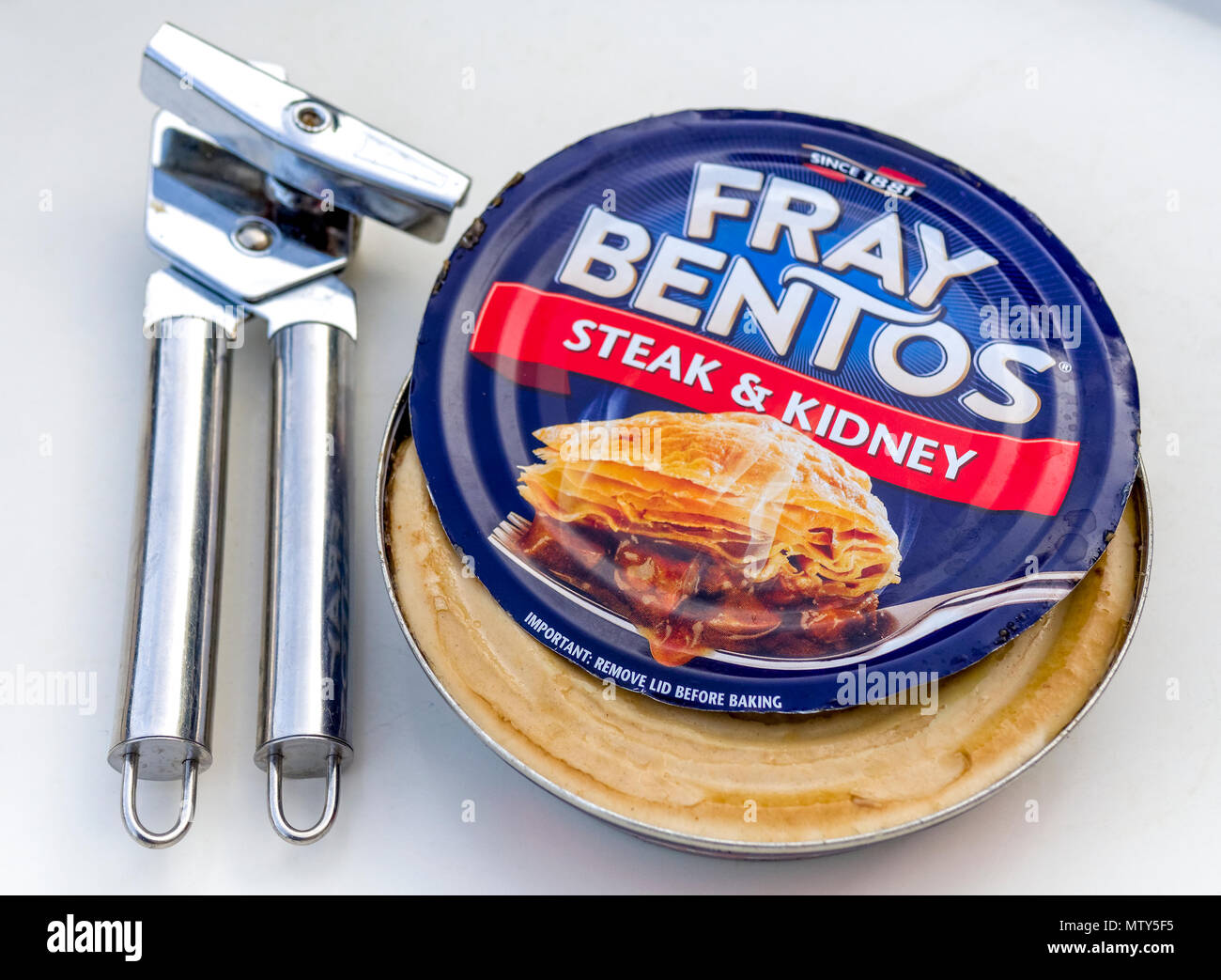 Fray Bentos Classic Steak & Kidney Pie in a Tin with Can Opener, Fray  Bentos was first formed around 1865 in Uruguay - Stock Image