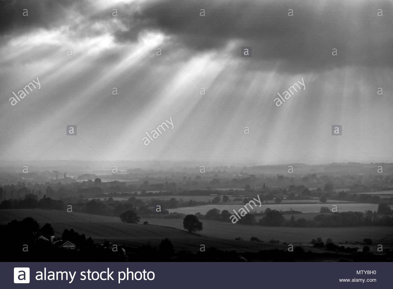 The sun's rays illuminate the Wiltshire Countryside near the villages of Edington and Bratton - Stock Image