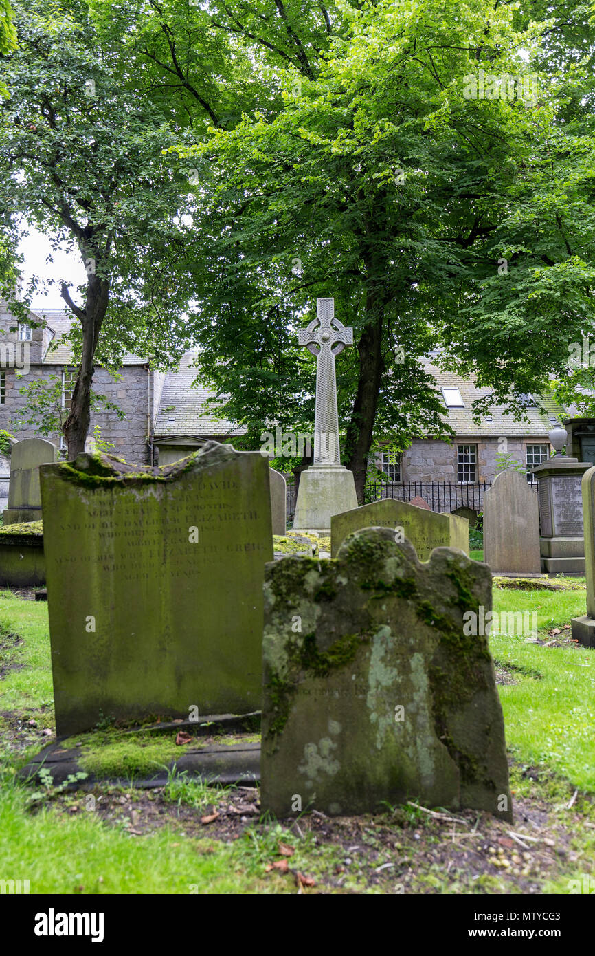 Grave stones and green trees at the  Kirk of Saint Nicholas Uniting. - Stock Image