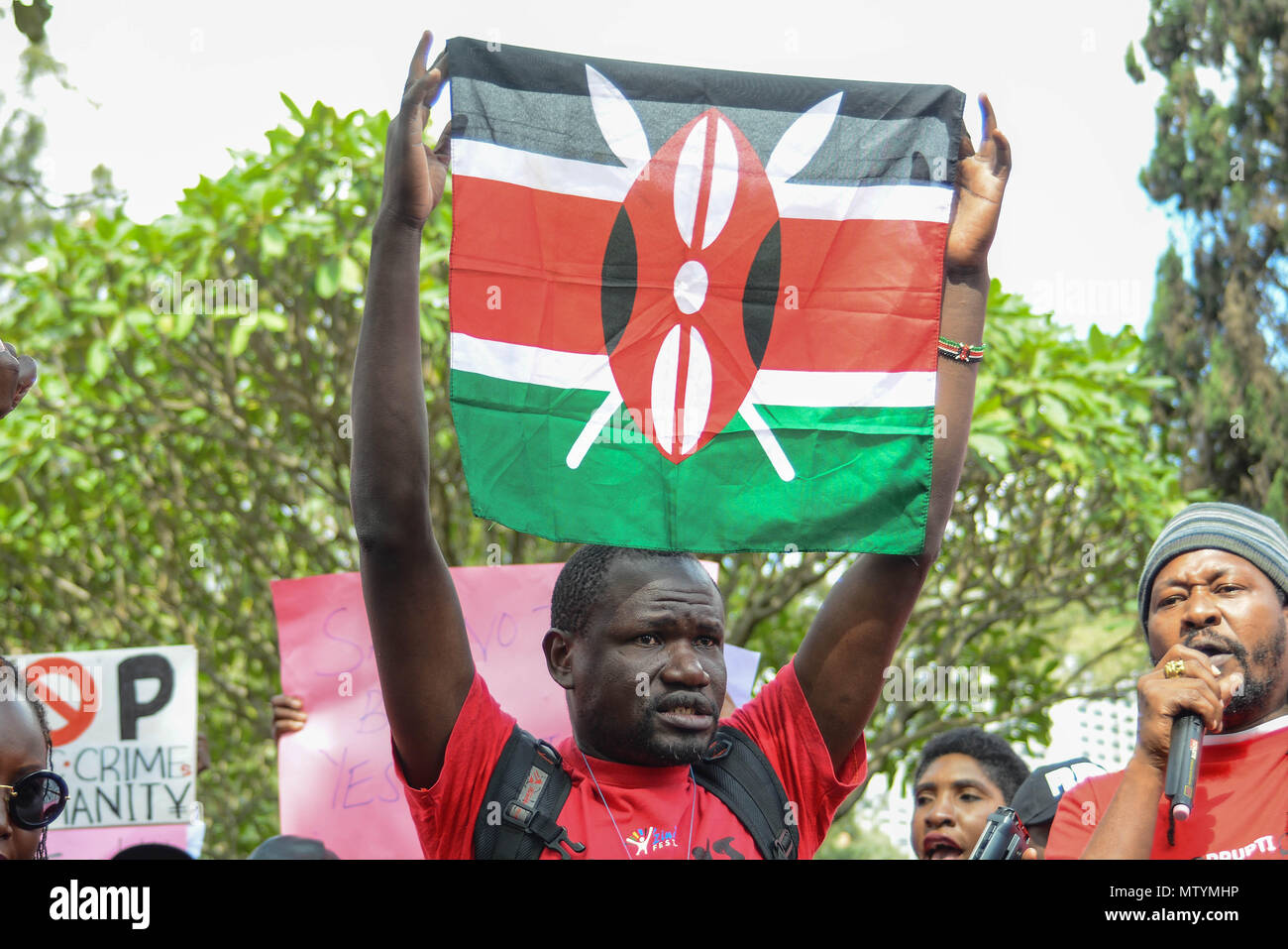 Nairobi, Kenya. 31st May, 2018. A protestor carry a Kenyan Flag as citizens protest in the streets of the capital city Nairobi. Protesters take the street to call the government to arrest people involved in massive corruption scandals. In a recent scandal involving National Youth Service (NYS), the Kenyan government lost Ksh9 billions in dubious tender deals. Credit: Allan Muturi/SOPA Images/ZUMA Wire/Alamy Live News Stock Photo