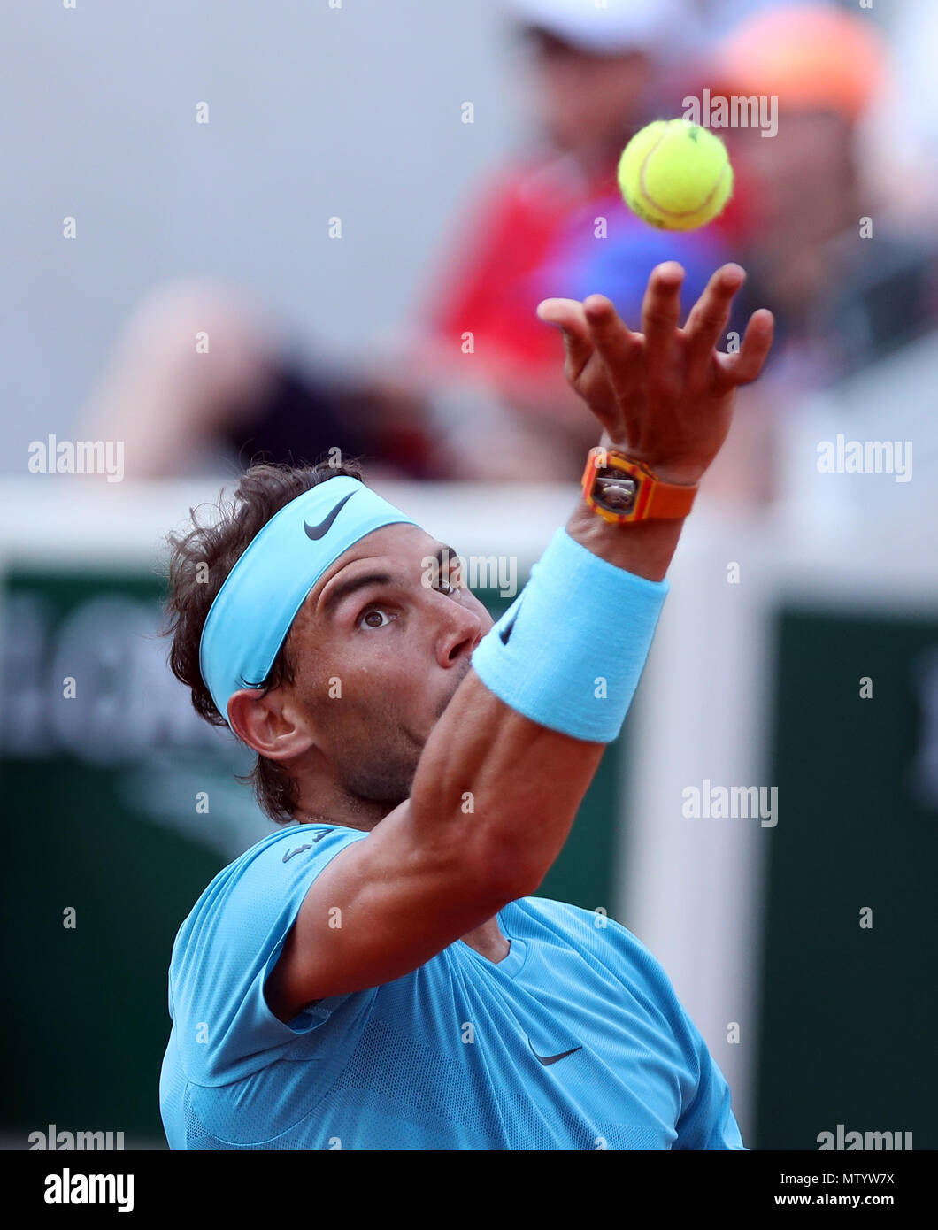 Paris. 31st May, 2018. 1st seeded Rafael Nadal of Spain serves during the men's singles second round match against Guido Pella of Argentina at the French Open Tennis Tournament 2018 in Paris, France on May 31, 2018. Credit: Luo Huanhuan/Xinhua/Alamy Live News Stock Photo
