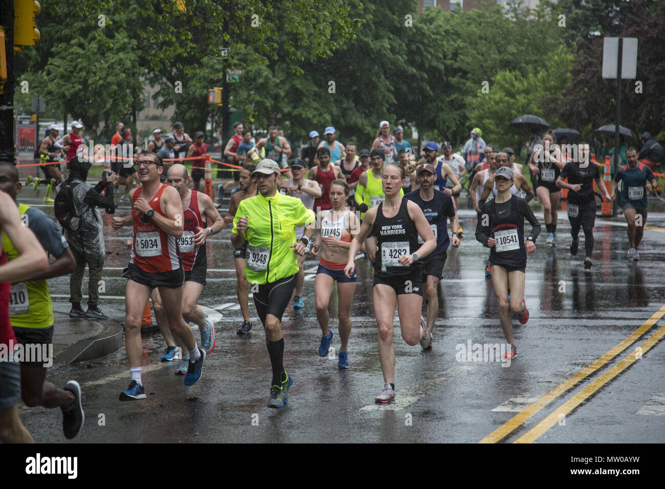50c567cb57 Runners race through the rain in Prospect Park during the first half of the  Brooklyn Half
