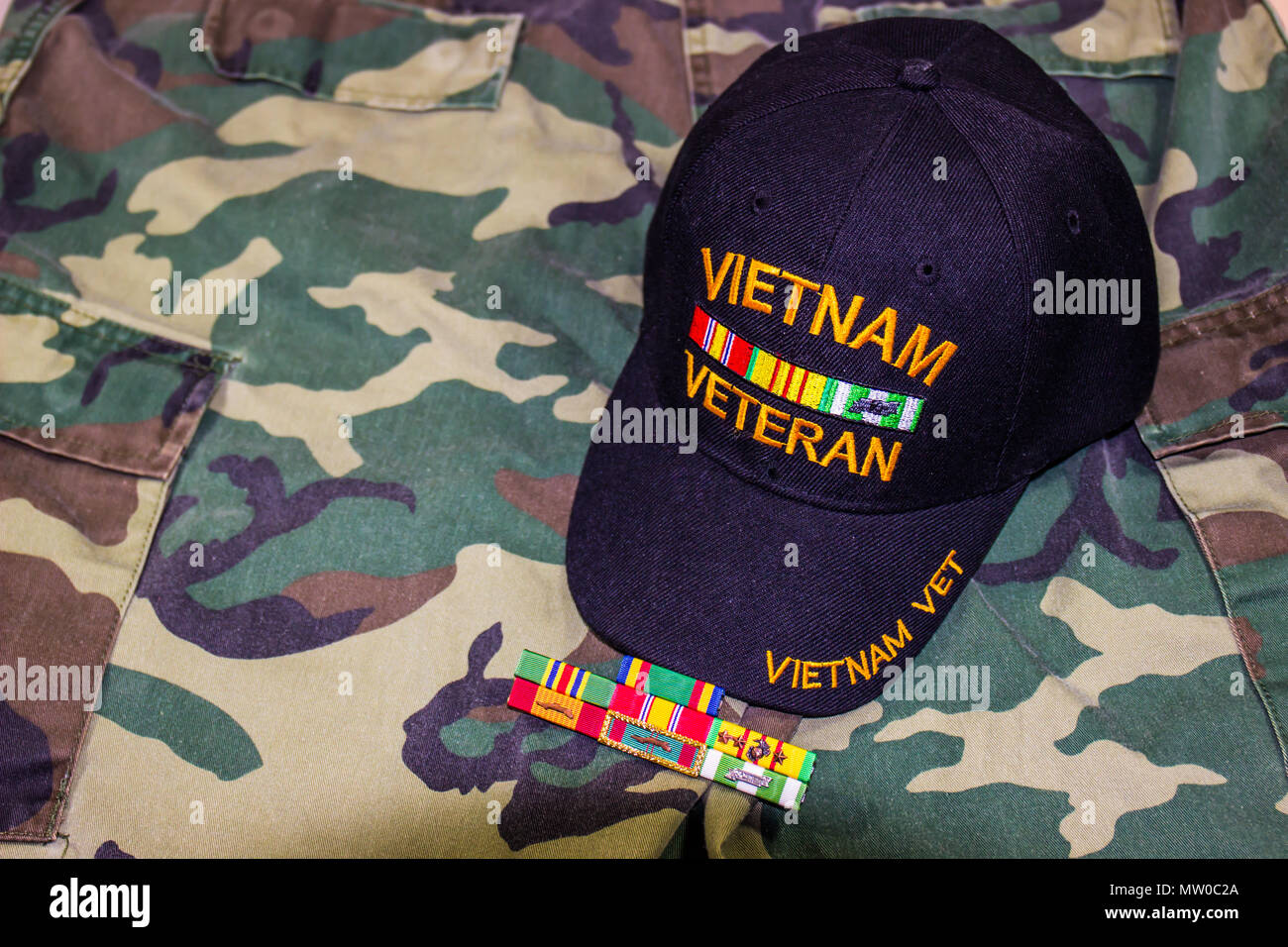 Vietnam Veteran Hat With Service Medals On Camouflage Uniform - Stock Image