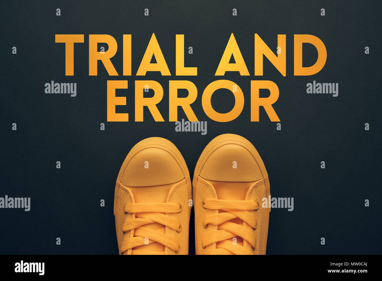 Trial and error problem solving concept with youth lifestyle type sneakers from above - Stock Image