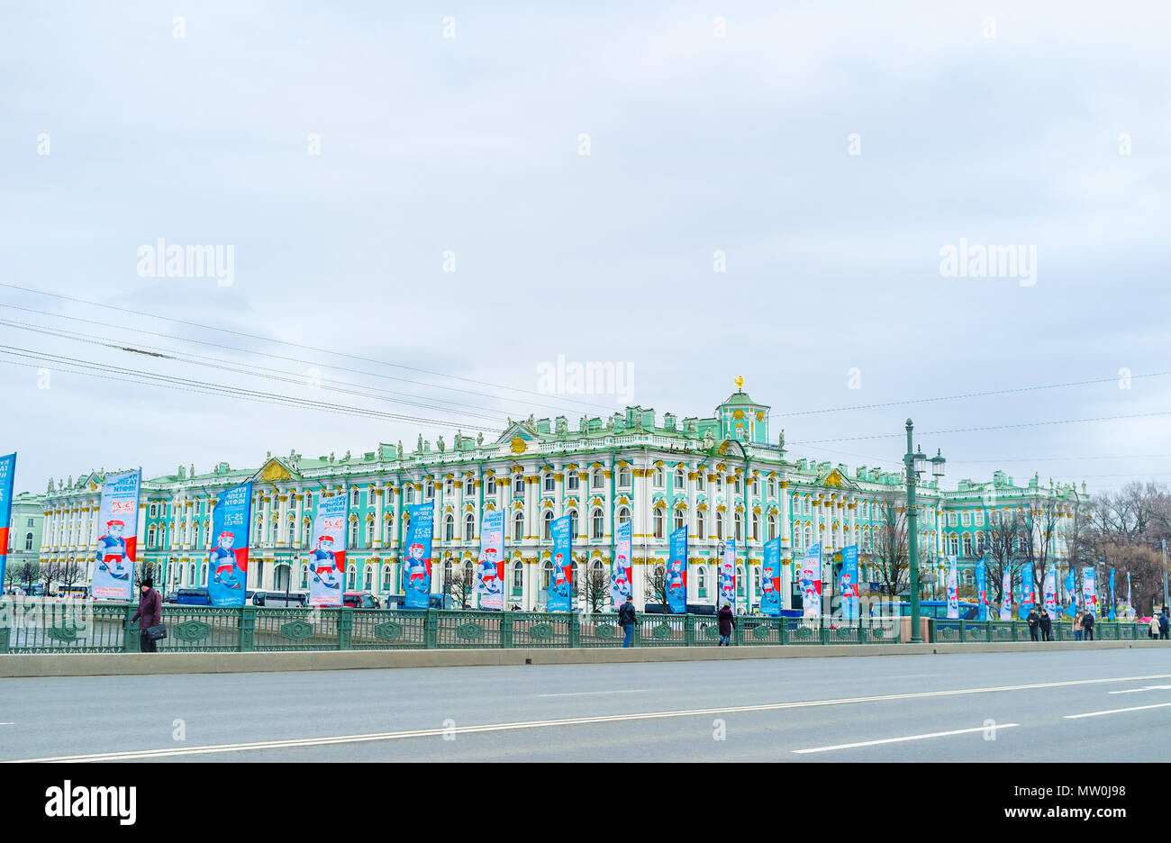 SAINT PETERSBURG, RUSSIA - APRIL 26, 2015: The view on Winter Palace through the Palace Bridge with flags dedicated to hockey competition, on April 26 Stock Photo