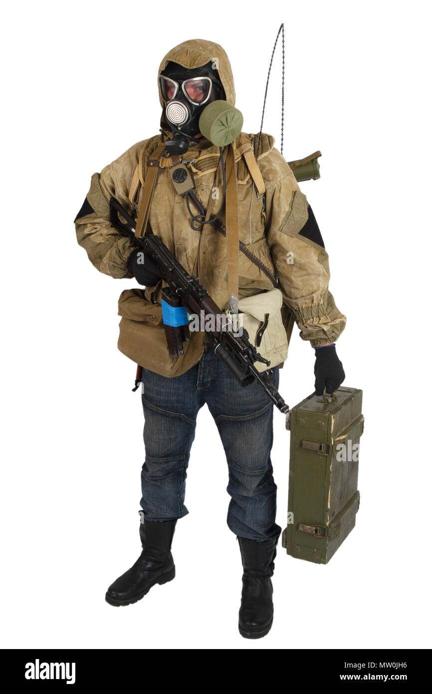 Stalker in gas mask with weapon isolated on white - Stock Image