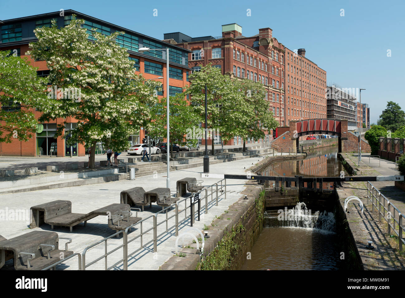 The Kitty Footbridge passing over the Rochdale Canal in the Ancoats area of Manchester, UK. Stock Photo