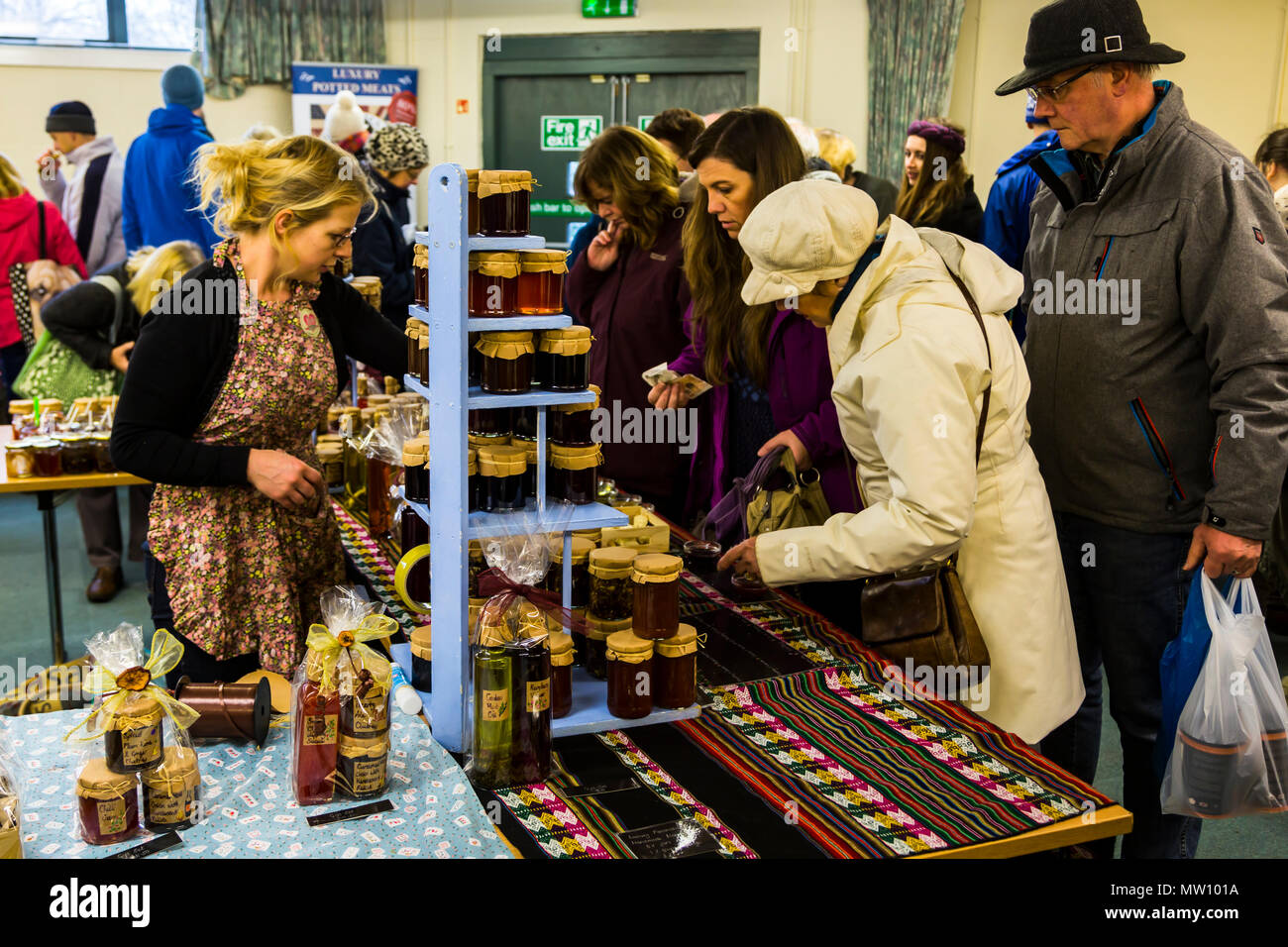 Home made jams, pickles, curds and chutneys on sale on a market stall. - Stock Image