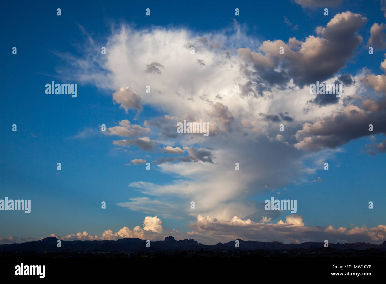 White Fluffy Clouds over Mojave Desert - Stock Image