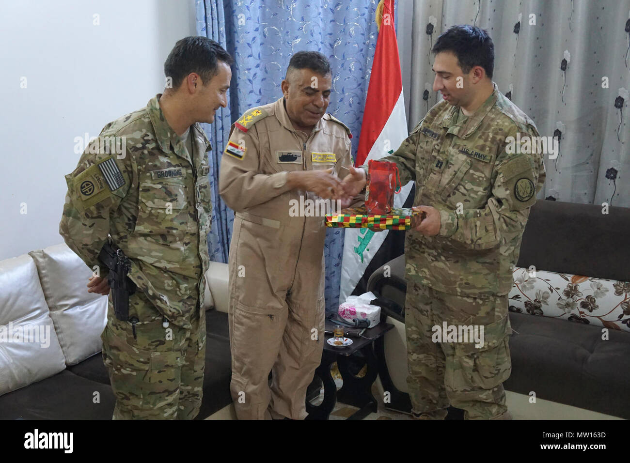 a75d92e6c44d6 U.S. Army Capt. Matt Kotowski (right) receives a present from the 9th Iraqi