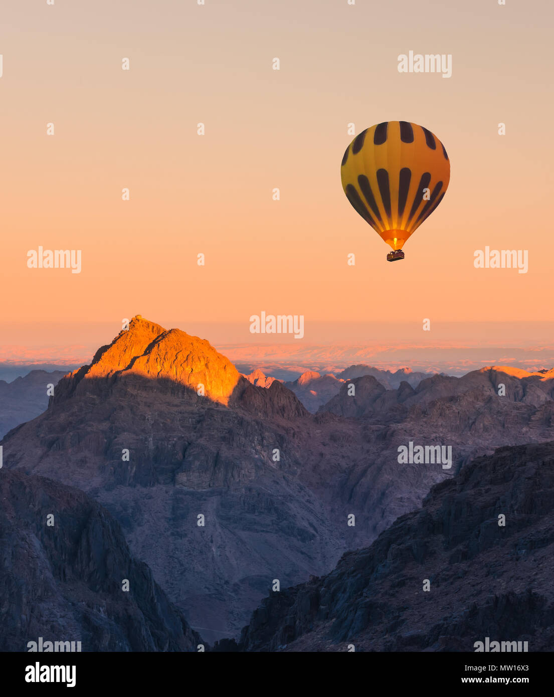 Hot air balloon over Mount Moses Sinai sunset - Stock Image